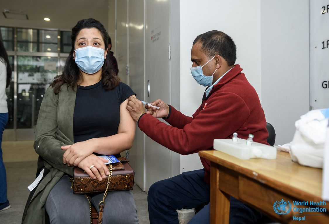 Person getting vaccinated by a professional