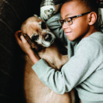 Young kid and a dog