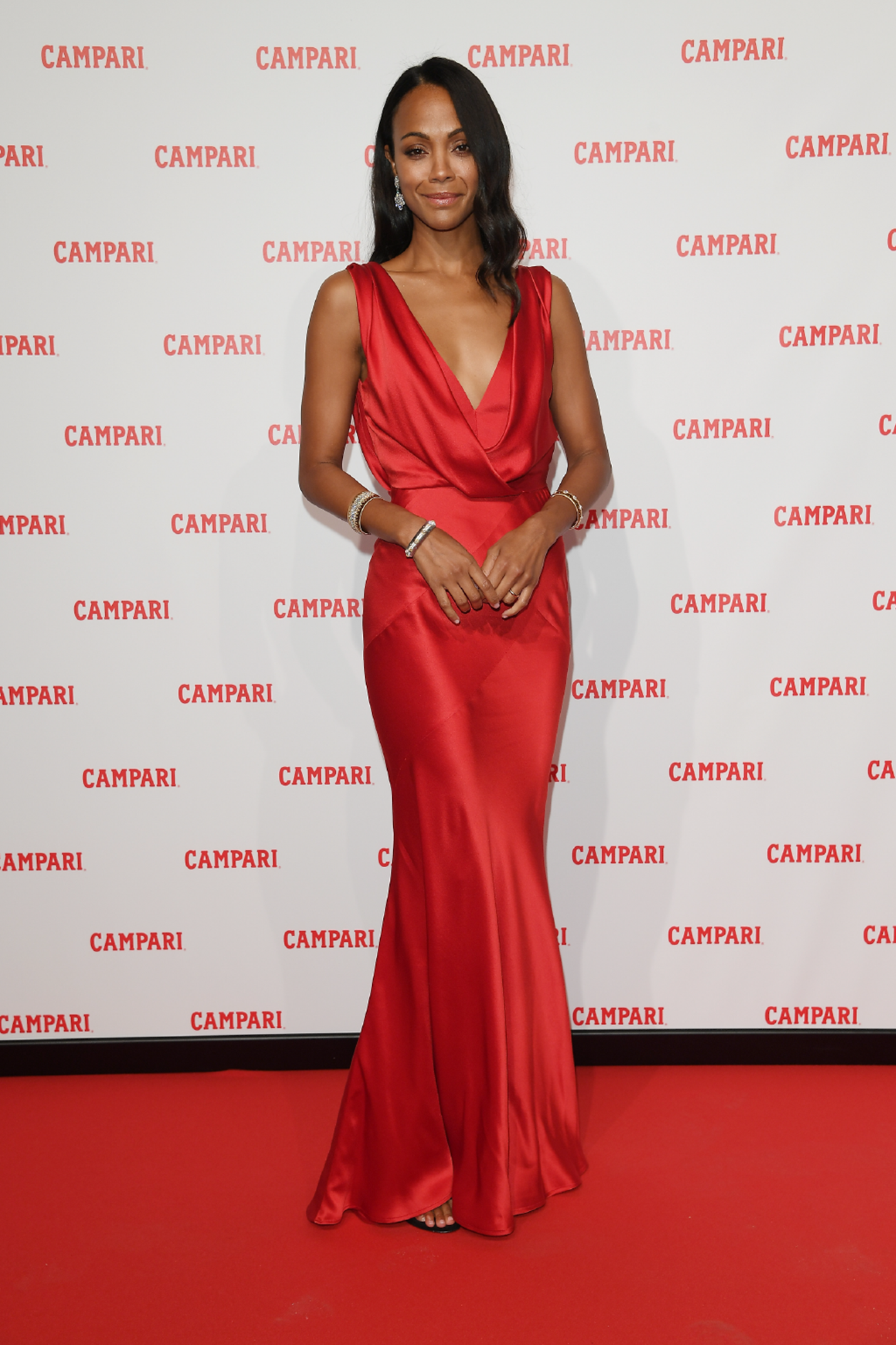 Zoe Saldana attends the premiere for the Campari Red Diaries short movie, 'The Legend of Red Hand' wearing dress by .Alberta Ferretti, earrings by Buccellati and .shoes by Stuart Weitzman Campari Red Diaries - Red Carpet Premiere on January 30, 2018 in Milan, Italy. (Photo by Venturelli/Getty Images for Campari)