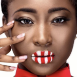 Laurie Jai wearing candy cane lipstick in red and white
